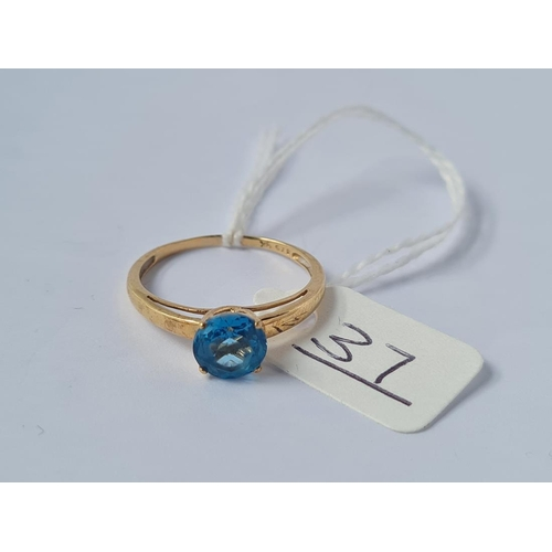 37 - A blue stone ring in 9ct - size Q - 1.8gms