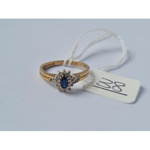 38 - A sapphire cluster ring in 9ct - size K.5 - 2.3gms