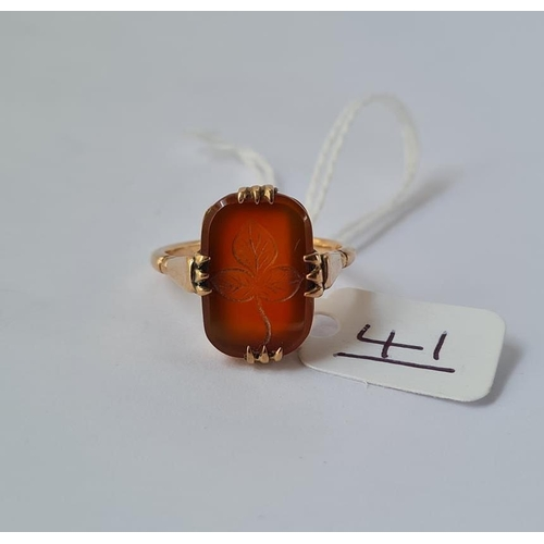 41 - A carved cornelian ring - size Q