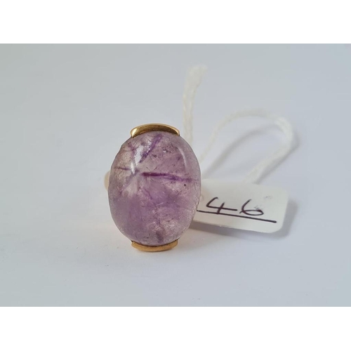 46 - A large cabochon amethyst ring in 9ct - size J - 12.4gms