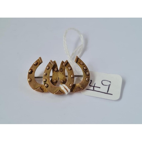 49 - A horse shoe brooch in 9ct - 3.2gms