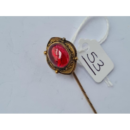53 - A large cabochon garnet stick pin with Victorian registration mark - 15ct gold tested