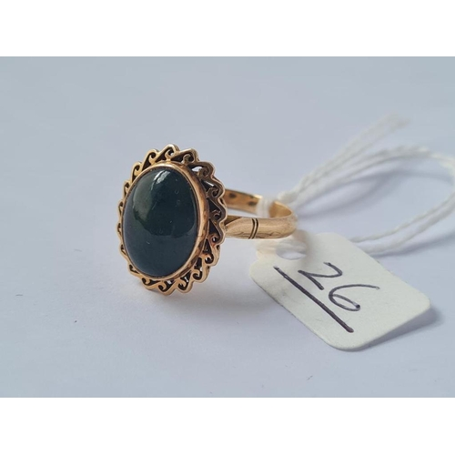 26 - A star sapphire ring in 14ct gold - size O - 4gms