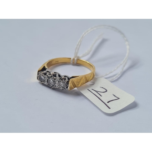 27 - A three stone diamond ring in 18ct gold - size Q.5 - 4gms