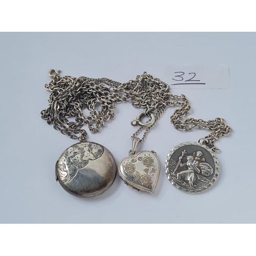 32 - Two silver lockets, chains etc.