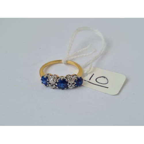 10 - A QUALITY 7 STONE SAPPHIRE & DIAMOND RING IN 18CT GOLD - size K - 3gms - central sapphire = 1cm - ou...