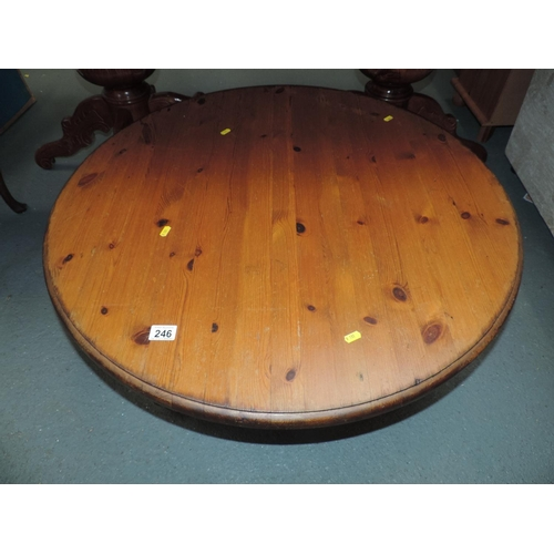 246 - Circular Pine coffee table on turned legs...