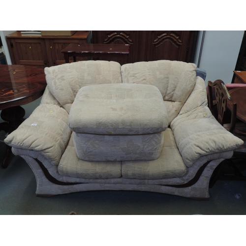249 - Modern cream patterned upholstered two seater settee with matching pouffe...