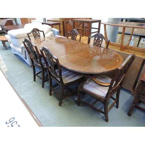 250 - Reproduction extending dining table with 4x wheel back chairs (two of which are carvers)...