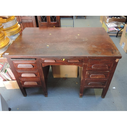 320 - Seven drawer office desk - 50''x 32''x 31''...