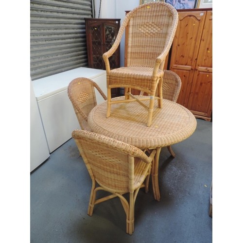 323 - Circular wicker conservatory table and 4x matching chairs...