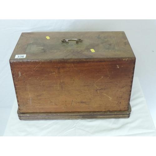 336 - Wood-cased sewing machine...