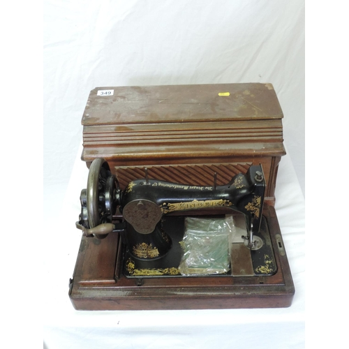 349 - Wood-cased sewing machine...