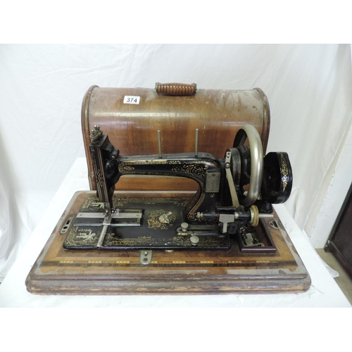374 - Wood cased sewing machine...