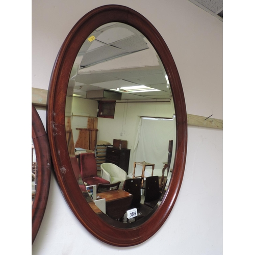 384 - Oval Bevel edge Mahogany framed mirror...