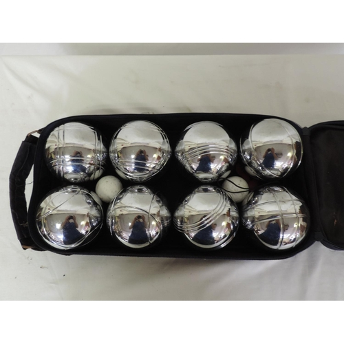 390 - Cased boules...