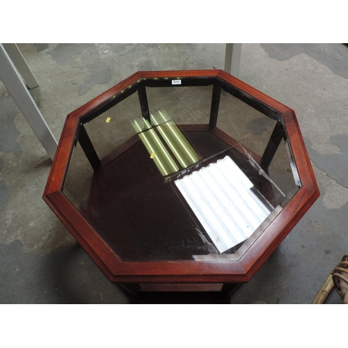 416 - Hexagonal glass top coffee table with shelf under...