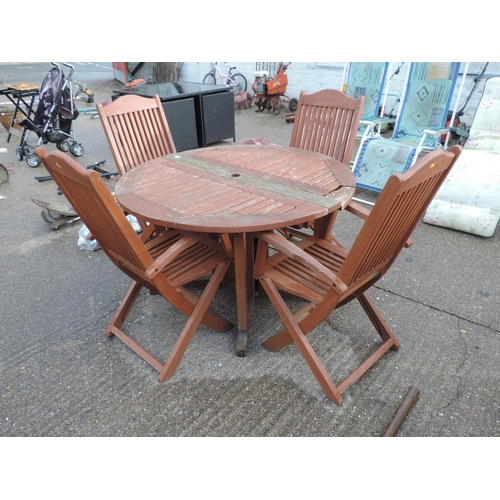 55 - Circular folding wooden garden table and 4x matching chairs...
