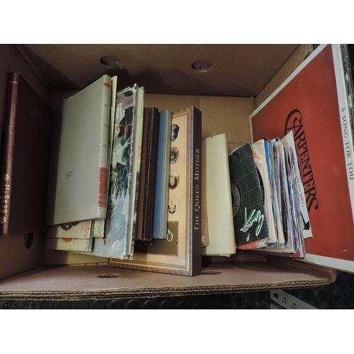 699 - Box of books, records, singles...