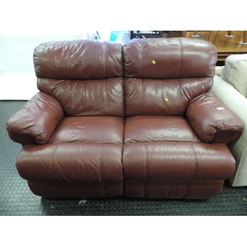 711 - Red Leather two seater reclining settee...