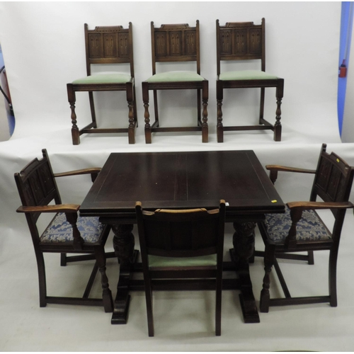 715 - Oak draw leaf table with 6x chairs (two of which are carvers)...