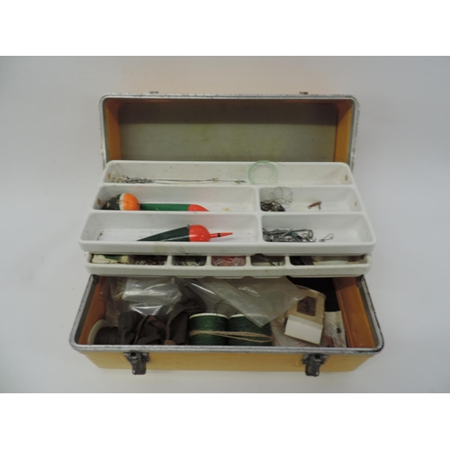730 - Sea fishing tackle box and contents, lead weights etc...