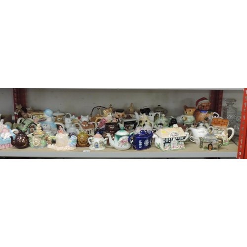 784 - Shelf (very large quantity) of novelty collector's tea pots...