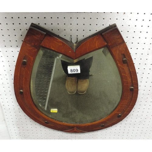 809 - Oak framed horse shoe mirror...