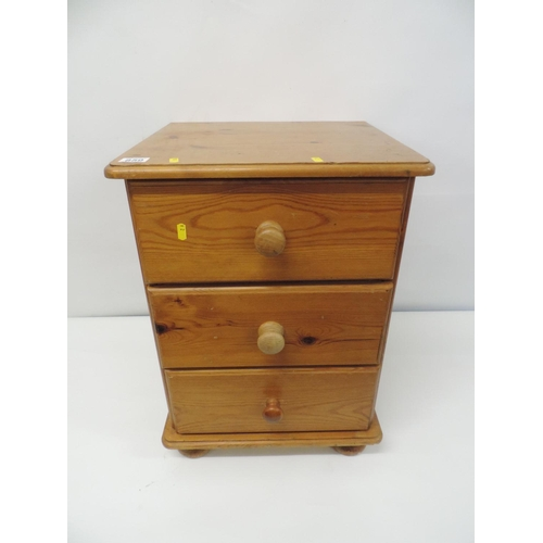 859 - Pine three drawer bedside cabinets...