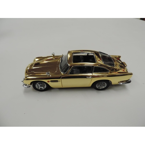 874 - Danbury Mint special edition James Bond 007 22ct Gold plated Aston Martin model car and display case...