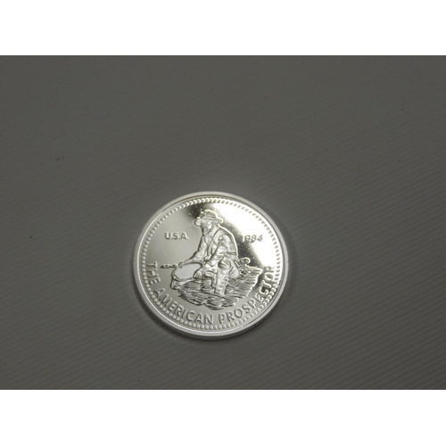 875 - Silver coloured American coin...