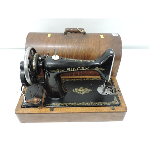 932 - Wood cased Singer sewing machine...