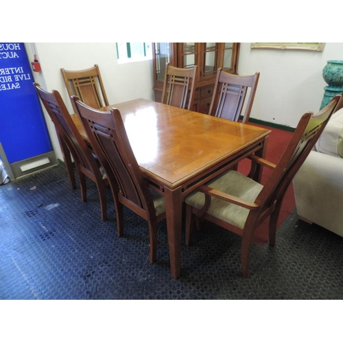 713 - Good quality modern extending dining table and 6x matching chairs (two of which are carvers)...