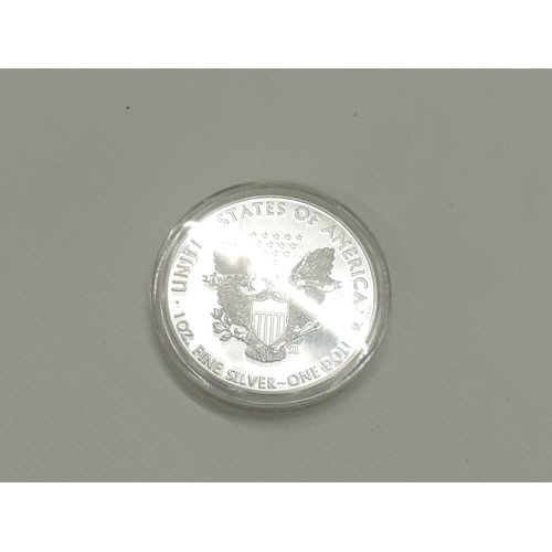 937 - Silver coloured American dollar...