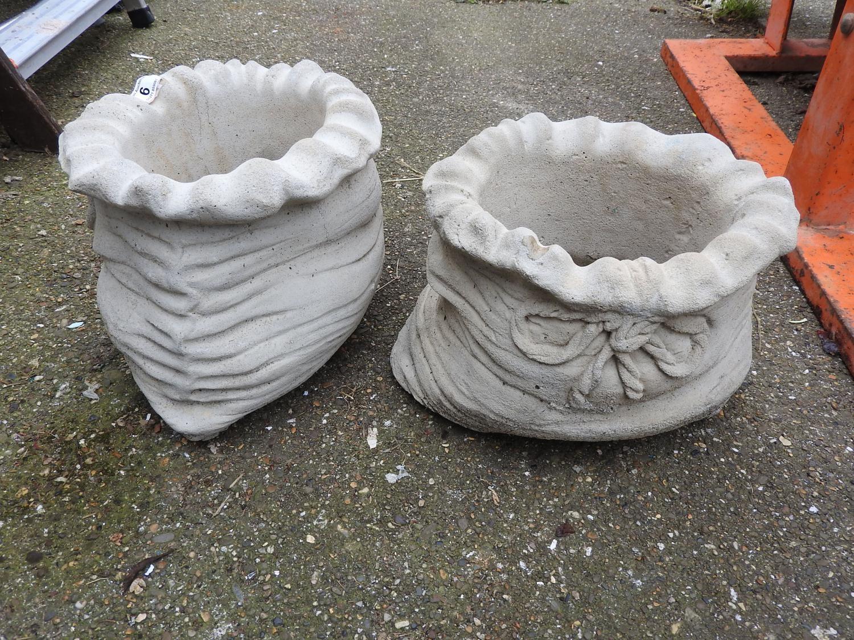 pair of concrete sack planters. Black Bedroom Furniture Sets. Home Design Ideas