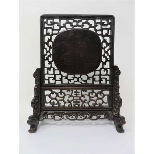 22 - A CHINESE JADE AND HARDWOOD TABLE SCREEN  19TH / 20TH CENTURY the pale celadon jade oval plaque carv...