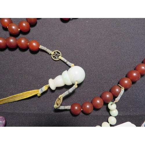 29 - A CHINESE CARNELIAN  AMETHYST AND JADE 'COURT' NECKLACE  QING DYNASTY the necklace comprised of one ...