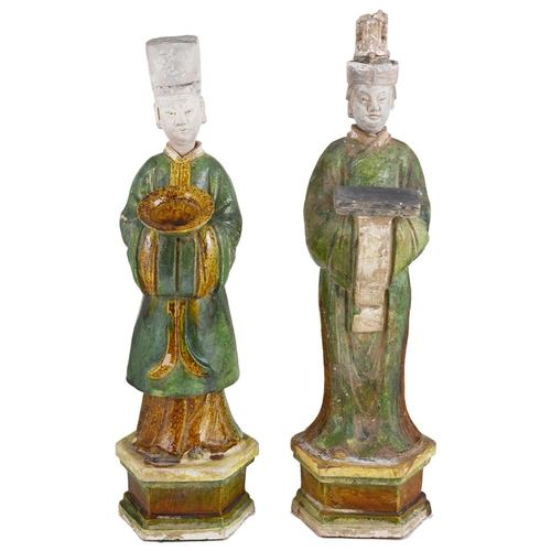 4 - A PAIR OF CHINESE SANCAI GLAZED POTTERY FIGURES OF ATTENDANTS  MING DYNASTY (1368-1644) standing in ...