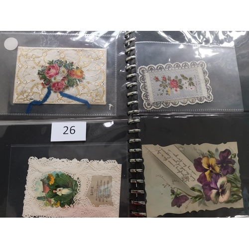26 - Various in 3 volumes  incl. early 20th century Christmas postcards  WWI silk cards  a pair of silk 1...