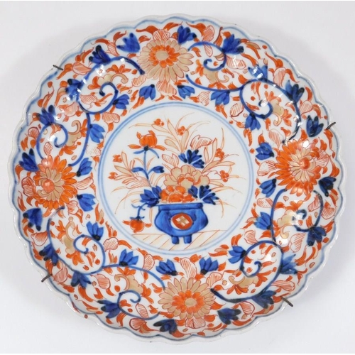 A pair of Japanese Meiji period Imari plates, each of shaped