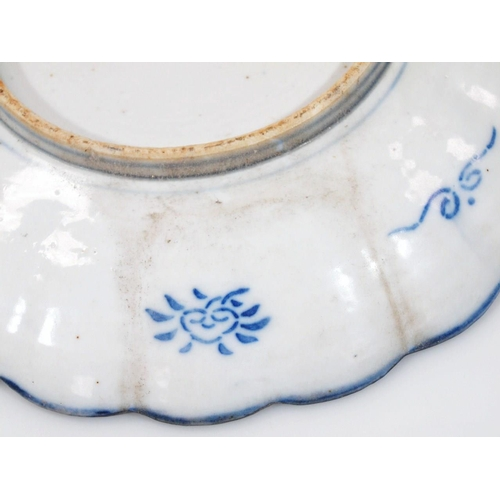 A pair of Japanese late Meiji period Imari plates, of shaped outline