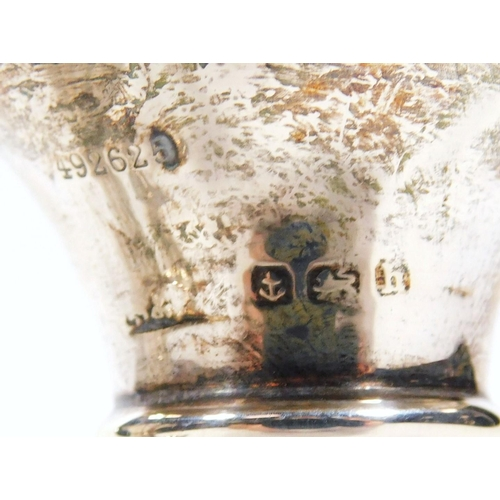 27 - Various silver, comprising of a George V vase, the bell shaped bowl flanked by S scroll handles, on ...