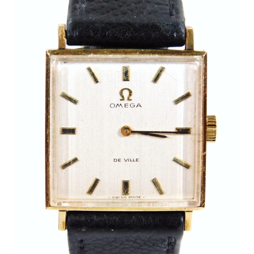 3 - A gentleman's Omega De Ville wristwatch, the square dial with baton pointers and numerals, with a bl...
