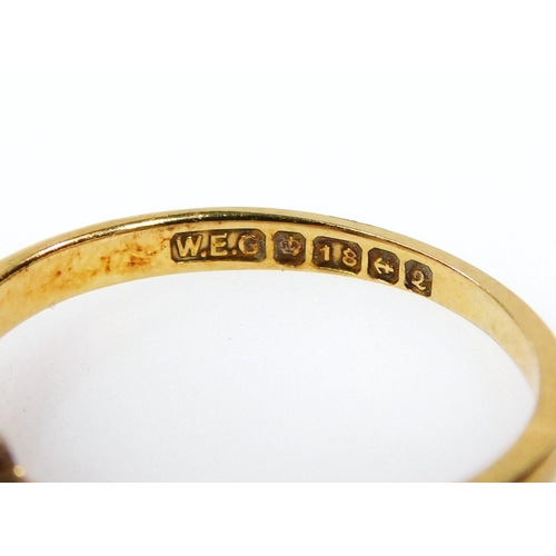 40 - A 18ct gold and diamond ring, the central stone flanked by four smaller stones,on a plain shank with...