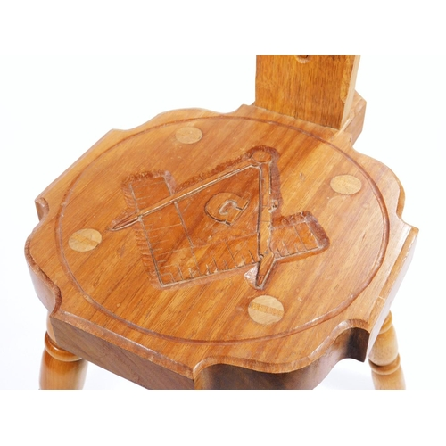 9 - A 20thC four pronged spinning chair, with carved Masonic emblem seat marked verso A Lord, with bee m...