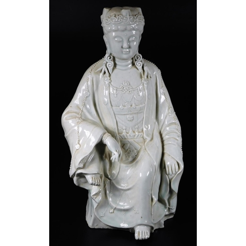 3006 - A Chinese blanc de chine figure, of a seated Buddhistic female, 42cm H....