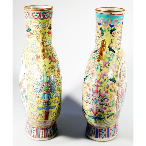 3025 - A pair of 19thC Chinese famille jaune porcelain moon flasks, each with compressed cylindrical stems ...