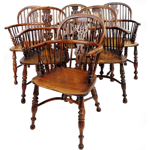 1 - A fine harlequin set of six early 19thC yew wood low back Windsor chairs, with pierced Christmas tre...