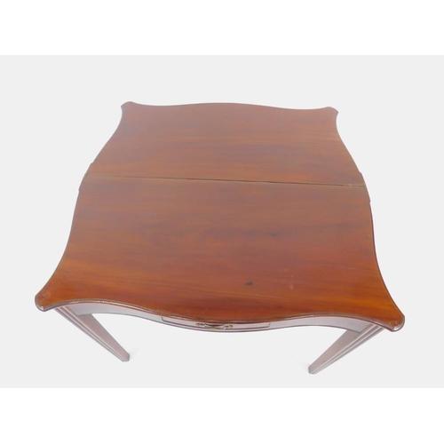 11 - A George III mahogany tea table, with serpentine plum pudding folding top, having thumb nail border ...