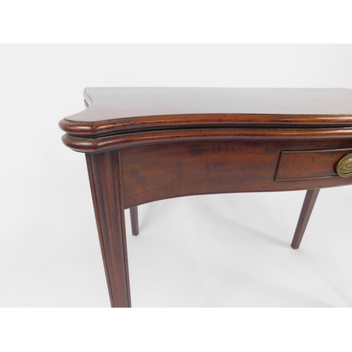 12 - A George III mahogany tea table, with serpentine plum pudding folding top, having thumb nail border ...